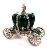 10 of Silver tone and green enamel crown attached to a coach shaped base