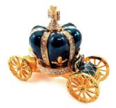 10 of Gold tone and green enamel crown attached to a coach (base)