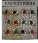 36 of Gold tone and silver tone rings with an intricate design